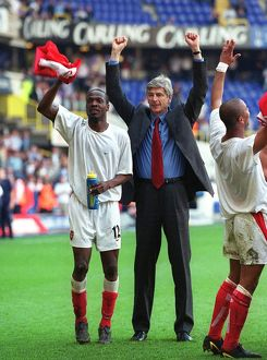 Arsene Wenger and Lauren celebrate at the end of the match