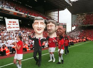 The Arsene Wenger and Tony Adams giant heads on the pitch during the final salute parade