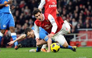 Cesc Fabregas (Arsenal) is fouled by Gary Caldwell (Wigan) for the Arsenal penalty