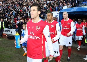 Cesc Fabregas and Gael Clichy (Arsenal) walk out onto the pitch