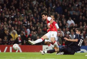 Cesc Fabregas scores Arsenal's 6th goal under pressure from Daniel Pudil