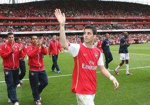 Cesc Fabregas waves to the Arsenal fans after the match