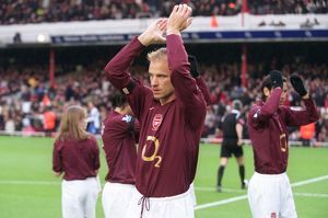 Dennis Bergkamp (Arsenal) claps the fans before the match