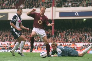 Dennis Bergkamp (Arsenal) Neil Clement and Tomasz Kuszczak (West Brom)