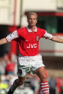 Dennis Bergkamp celebrates scoring his first goal for Arsenal