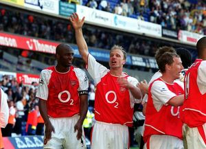 Dennis Bergkamp and Patrick Vieira celebrate winning the league