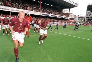 Dennis Bergkamp and Thierry Henry (Arsenal) run out at the start of the match