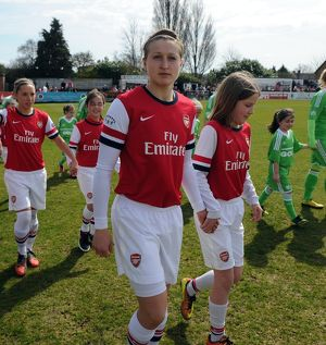 ellen white arsenal with a mascot before the match