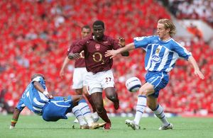 Emmanuel Eboue (Arsenal) Henri Camara and Reto Ziegler (Wigan)