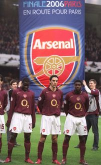 Emmanuel Eboue, Robert Pires and Kolo Toure (Arsenal) line up with an banner behind them