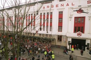 Fans gather outside the East Stand on Avenell Road to watch the Arsenal team arrive at the stadium