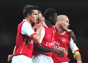 Freddie Ljungberg is congratulated on scoring Arsenal's