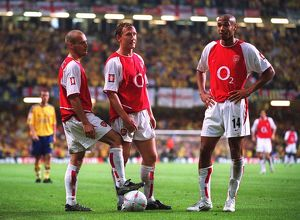 Freddie Ljungberg, ray Parlour and Thierry Henry (Arsenal) stand over the ball before taking a free