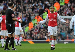 Gael Clichy (Arsenal) talks to referee Mark Clattenburg