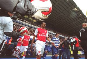 Gilberto (Arsenal) enters the pitch for the start of the match
