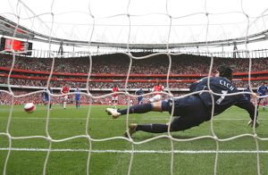 Gilberto shoots past Chelsea goalkeeper Petr Cech to score the Arsenal from the penalty spot