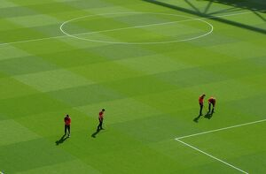 the groudstaff work on the pitch before the match