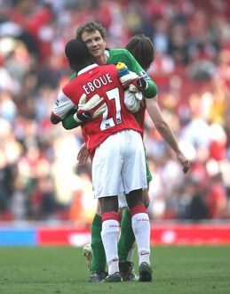 Jens Lehmann and Emmanuel Eboue celebrate after the match