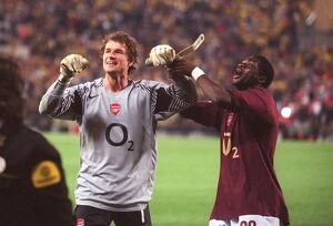 Jens Lehmann and Kolo Toure (Arsenal) celebrate their draw that puts them into the final
