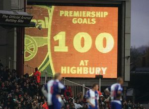 The jumbotron informs the fans that Thierry Henry has scored 100 Premiership goals at Highbury