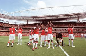 Kolo Toure and Johan Djourou (Arsenal) clap the fans along with the rest of the team