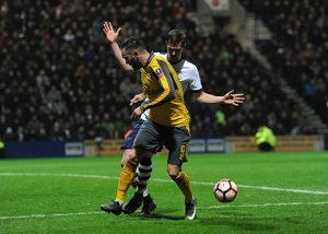 lucas perez arsenal back heels the ball