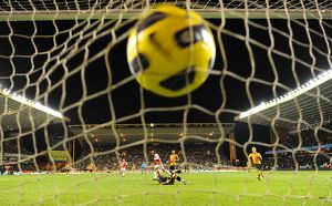 marouane chamakh shoots past wolves goalkeeper marcus