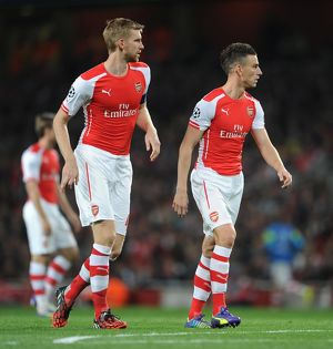 Per Mertesacker and Laurent Koscielny (Arsenal). Arsenal 1:0 Besiktas. UEFA Champions