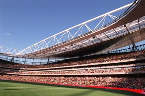 A mexican wave goes around Emirates Stadium, east side