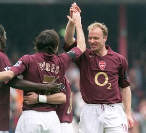 Robert Pires celebrates scoring Arsenal's 2nd goal with Dennis Bergkamp