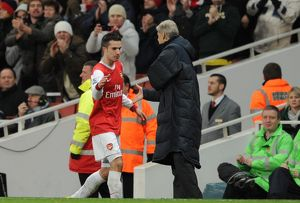 Robin van Persie (Arsenal) is congratulated by Manager Arsene Wenger on his hat trick as he is subbed. Arsenal 3:0 Wigan Athletic. Barclays Premier League. Emirates Stadium, 22/1/11. Credit : Arsenal Football Club /