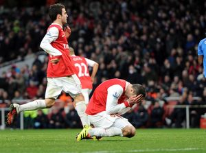 Robin van Persie (Arsenal) reacts to missing from the penalty spot. Arsenal 3