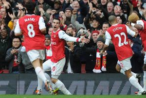 Robin van Persie celebrates scoring the 1st Arsenal goal with Gael Clichy and Samir Nasri