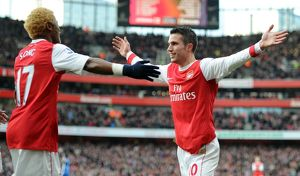 Robin van Persie celebrates scoring his and Arsenal's 1st goal with Alex Song