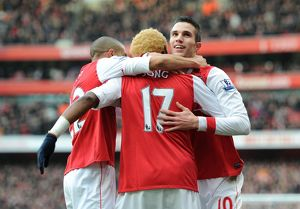 Robin van Persie celebrates scoring his and Arsenal's 1st goal with Gael Clichy