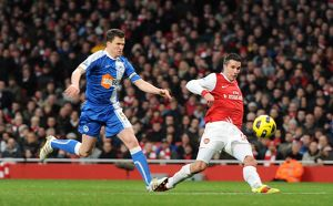 Robin van Persie scores his and Arsenal's 2nd goal under pressure from Gary Caldwell