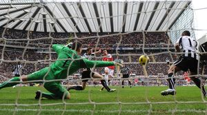 robin van persie shoots past newcastle goalkeeper steve