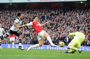 samir nasri knocks the ball past heurelho gomes tottenham