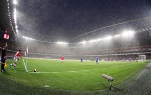Snow falls during the match at Emirates. Arsenal 2:2 Everton. Barclays Premier League