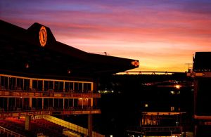 The Sun sets over The Arsenal and Emirates stadiums