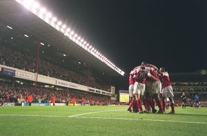 the arsenal players celebrate robert pires 2nd goal