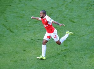theo walcott celebrates scoring arsenals