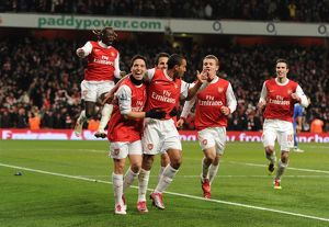 Theo Walcott celebrates scoring Arsenal's 3rd goal with his team mates