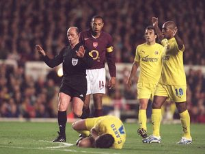 thierry henry arsenal looks on as cesar arzo