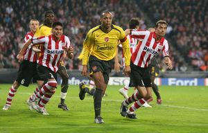 Thierry Henry (Arsenal) Phillip Cocu and Carlos Salcidio (PSV)