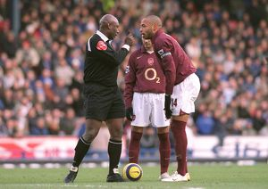 Thierry Henry (Arsenal) is told to wait for the whistle by Referee U. Rennie