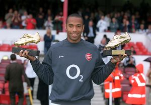 Thierry Henry (Arsenal)with his golden boot awards