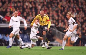 Thierry Henry beats Alvaro Mejia (Real) on his way to scoring Arsenal's goal