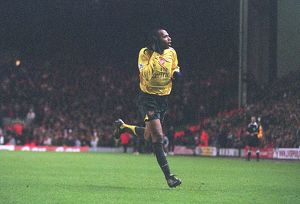 Thierry Henry celebrates scoring the 3rd Arsenal goal