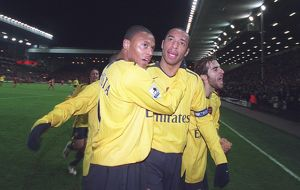 Thierry Henry celebrates scoring the 3rd Arsenal goal with Julio Baptista